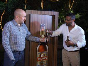 St.John Gould - Director, UK Trade & Prosperity unveiling Witlinger Bottle